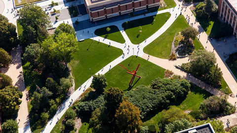 Aerial image of campus showing Love Library and walking paths